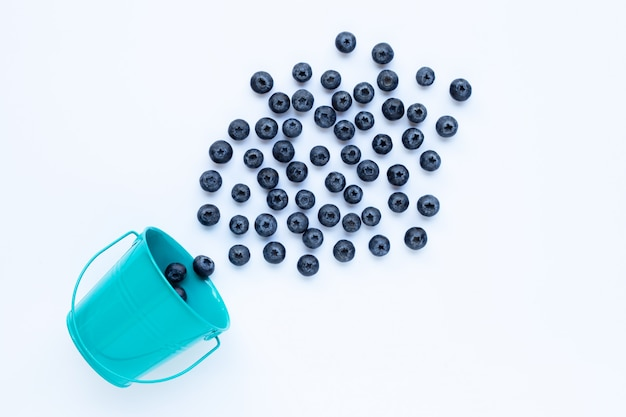 Blueberries with bucket isolated on white Premium Photo