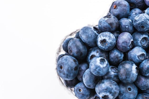Blueberry basket isolated on white Free Photo