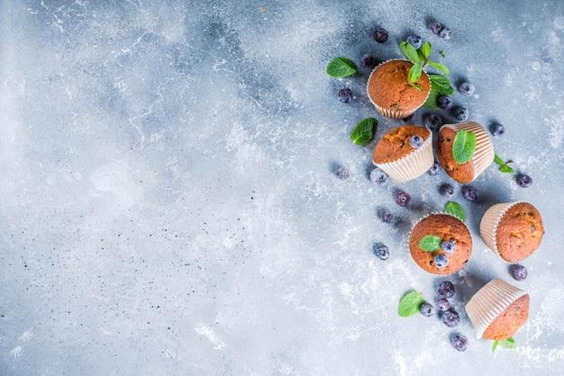 Blueberry muffins with fresh berries Premium Photo