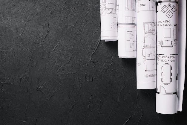 Blueprints on black table Free Photo