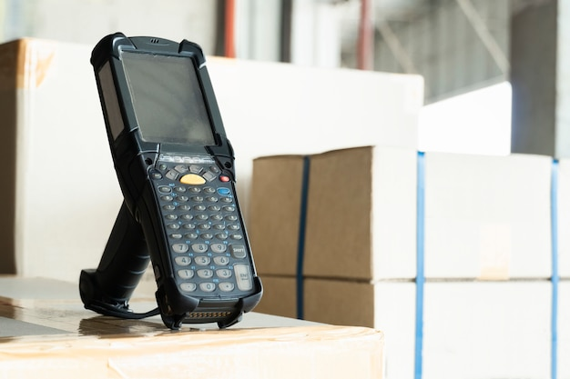Bluetooth barcode scanner on shipment boxes, manufacturing cargo warehouse export. computer equipment for inventory management. Premium Photo