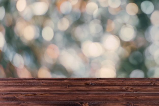 Blur bokeh with wooden table top for background, industrial dark color tone. Premium Photo