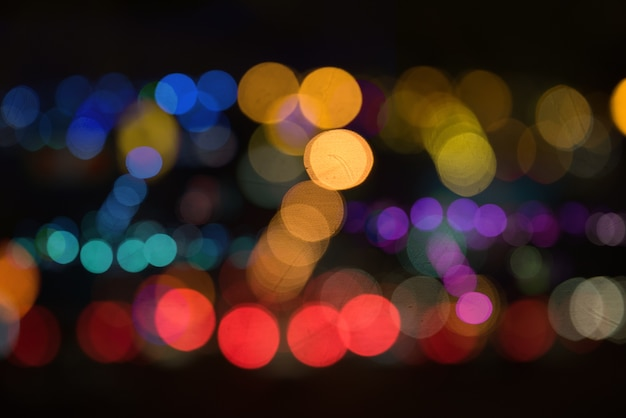Blur image of city at night.blurred urban abstract traffic background Premium Photo