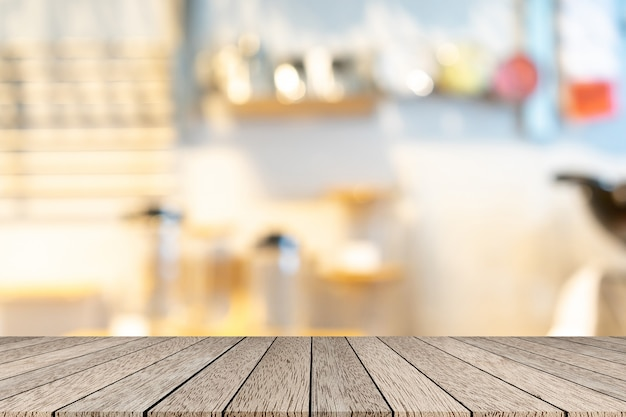 Blur inside restaurant with wood table Premium Photo