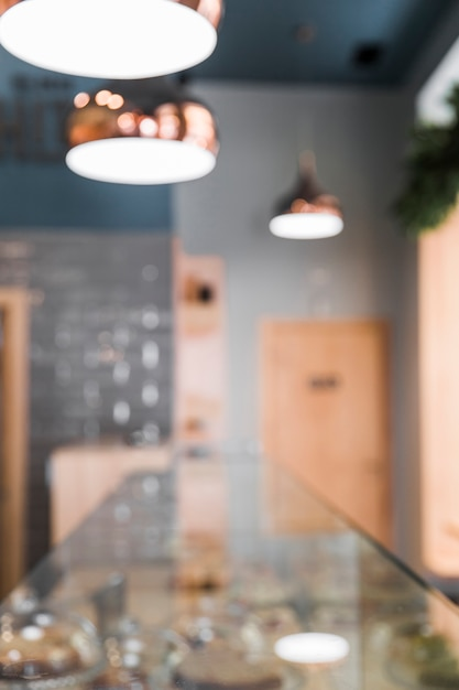 Blur interior of coffee shop with lighting equipment Free Photo