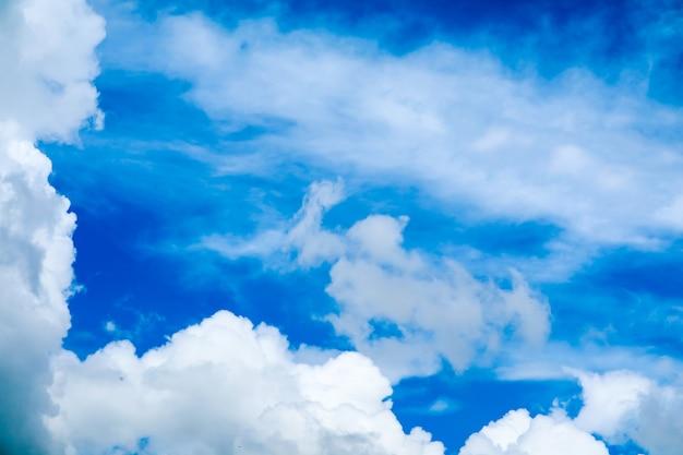 Blur white heap cloud sunshine in summer  blue sky soft cloud Premium Photo