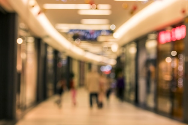 Blurred abstract background of corridor in shopping mall Free Photo