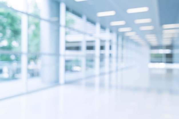 Blurred abstract background interior view looking out toward to empty office lobby and entrance doors and glass curtain wall with frame Free Photo