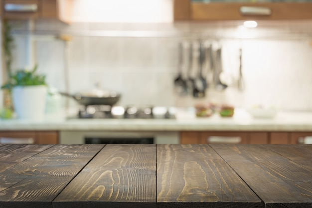 Blurred abstract background. modern kitchen with tabletop and space for display your products. Premium Photo