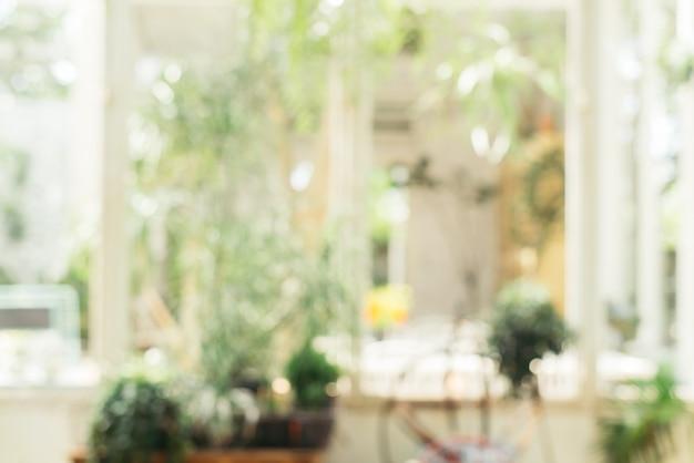 Размытый фон - кофейня в саду размытия фон с боке. винтажное отфильтрованное изображение. Бесплатные Фотографии