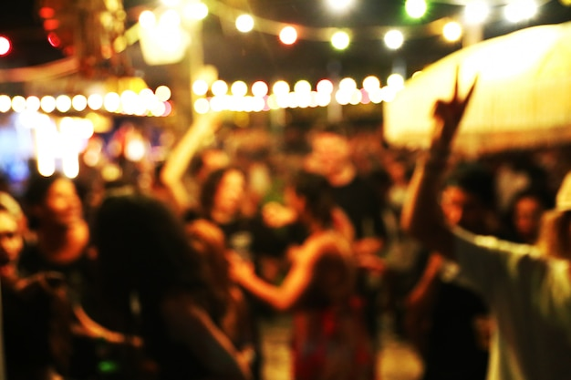 Blurred background of many people had fun at a beach party Premium Photo