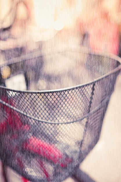 Blurred Bicycle basket with Rain in Vintage tone. Free Photo
