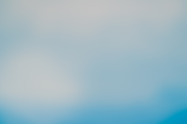 Blurred blue sky and sea well use as .blur backdrop of ocean concept.blurry pastel colored of sunshine Free Photo