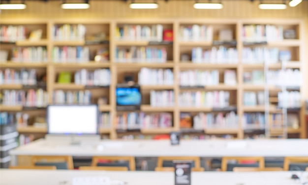 Blurred bookshelf in library room Premium Photo