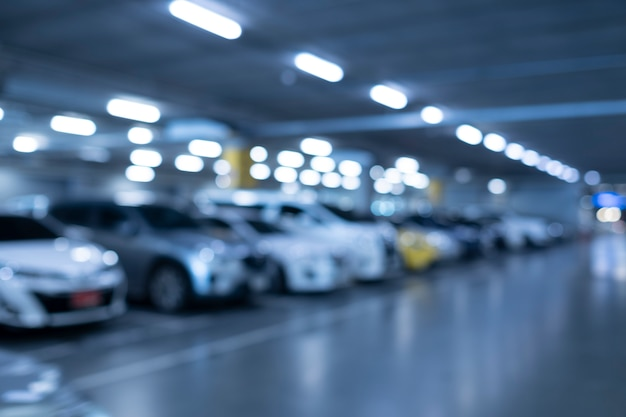 Blurred car parking in shopping mall Premium Photo