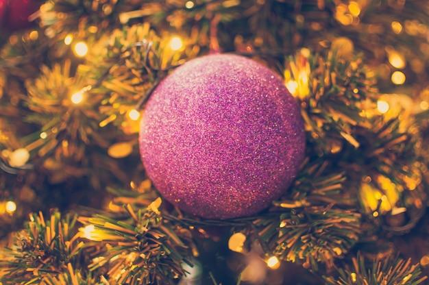blurred christmas lights and christmas ball background premium photo - Blurred Christmas Lights