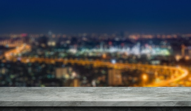 Blurred city background with cement floor for display products. Premium Photo