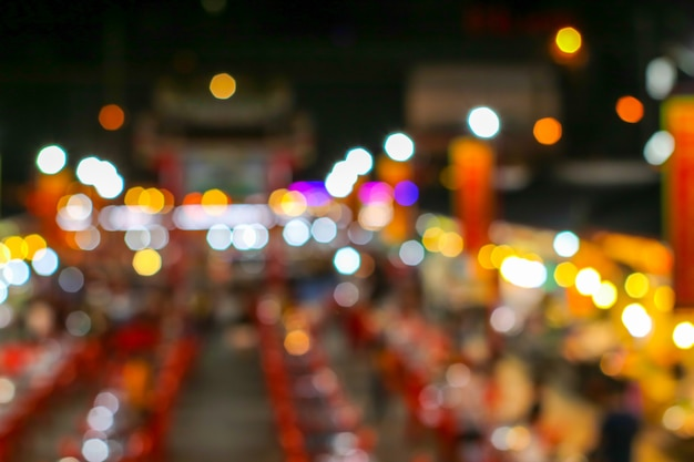 Blurred colorful light image of china town restuarest and local market Premium Photo