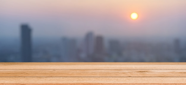 Blurred dark night city background with wood panels perspective for show promote product concept Premium Photo