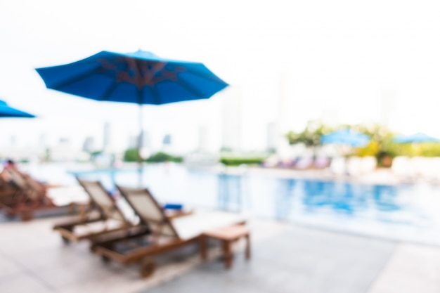 Blurred Deck Chairs With Swimming Pool Background Free Photo