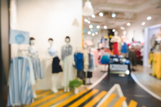 Blurred image of boutique display with mannequins in fashionable dresses for background Premium Photo
