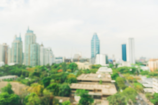 Blurred industrial city backgrounds - blur of bangkok city town with sunset and twilight sky and bokeh light view form roof top of building. blur backgrounds concept. Premium Photo