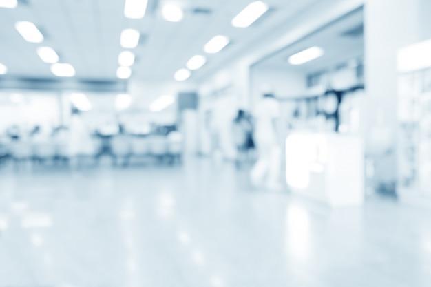 Размытые интерьер больницы или клинические с людьми - абстрактные медицинские фон. Premium Фотографии