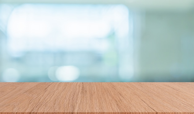 Blurred modern interior bathroom background with brown wood tabletop for show,ads,design Premium Photo