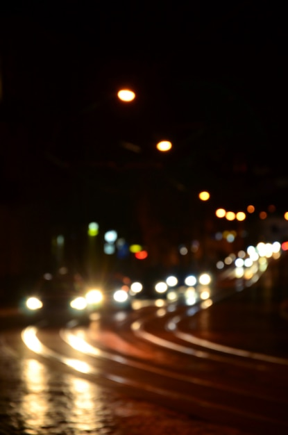 Blurred night scene of traffic on the roadway. Premium Photo