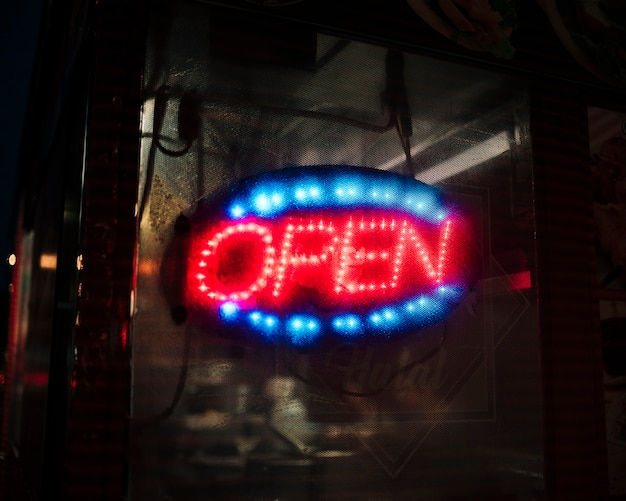 Blurred open sign in neon lights Free Photo