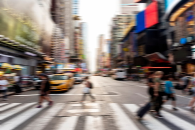 Blurred people crossing the street Free Photo