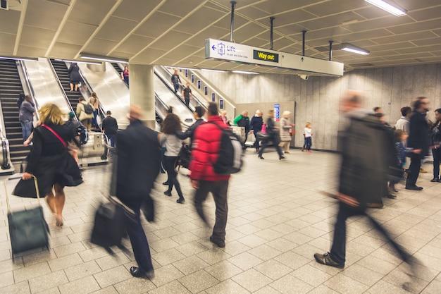 Blurred people walking inside train station Premium Photo