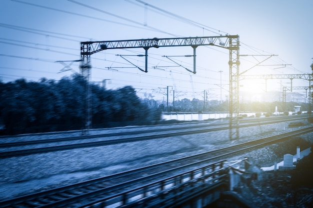 Blurred railway with sunbursts Free Photo