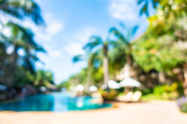 Blurred scene of outdoor swimming pool in hotel resort Free Photo