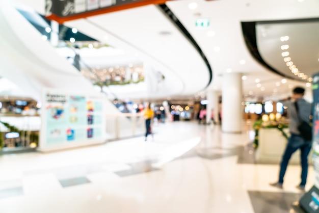 ぼやけたショッピングモールと小売店 Premium写真
