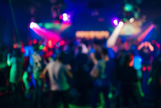 Blurred silhouettes of people dancing in a nightclub Premium Photo