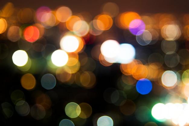 Blurred street bokeh lights at night time Free Photo