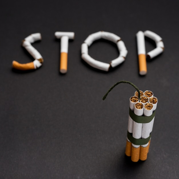 blurred-text-stop-made-from-cigarette-wi