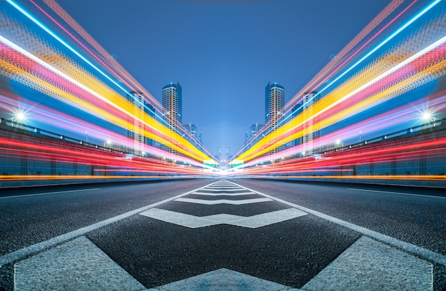 Blurred traffic light trails on road Free Photo