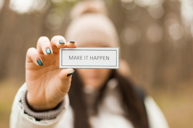 Blurred woman with motivating writing Free Photo