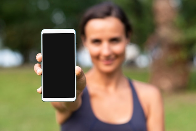 Blurred woman with smartphone mock-up Free Photo
