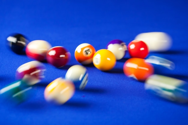 Blurry And Moving Of Billiard Balls In A Blue Pool Table Photo - Pool table movers delaware