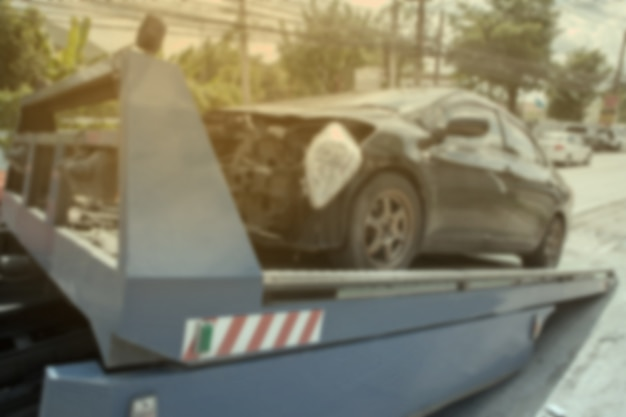 Blurry background of black car on accident on the forklift. Premium Photo