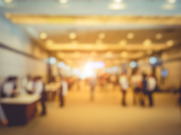 Blurry background of exhibition expo with crowd people in convention hall Premium Photo