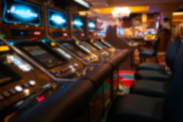 Blurry background of slot machines at the casino Premium Photo