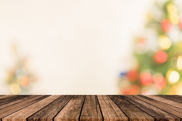Blurry christmas tree with plank wooden texture floor background Premium Photo