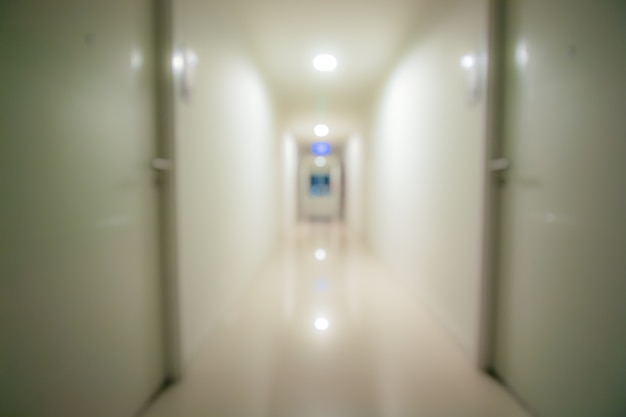 Blurry hall way, walking path in condominium Premium Photo