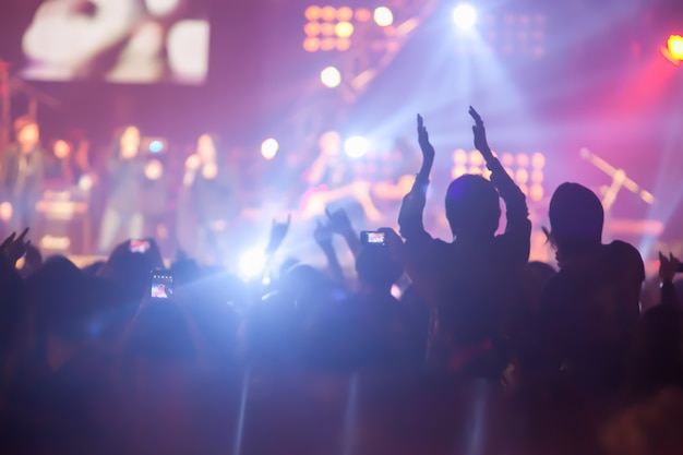 Blurry image background of many audience concert in big rock concert. Premium Photo