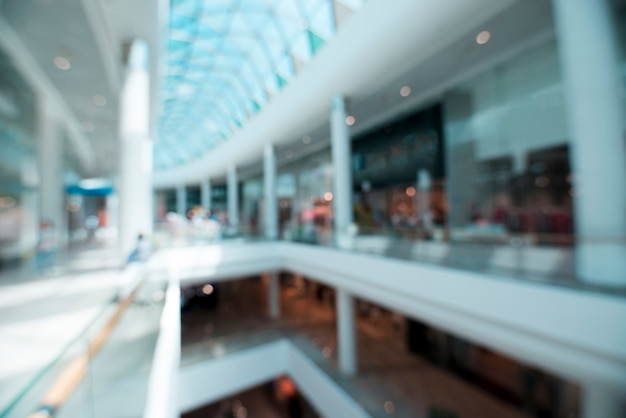 Blurry shot of interior of a shopping mall Free Photo