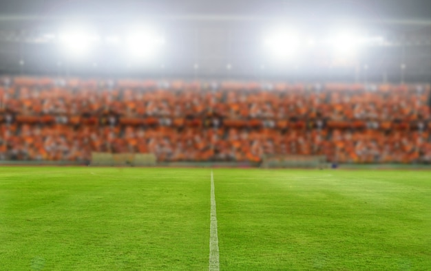 Blurry and soft focus of football stadium and arena soccer field championship win for back Premium Photo